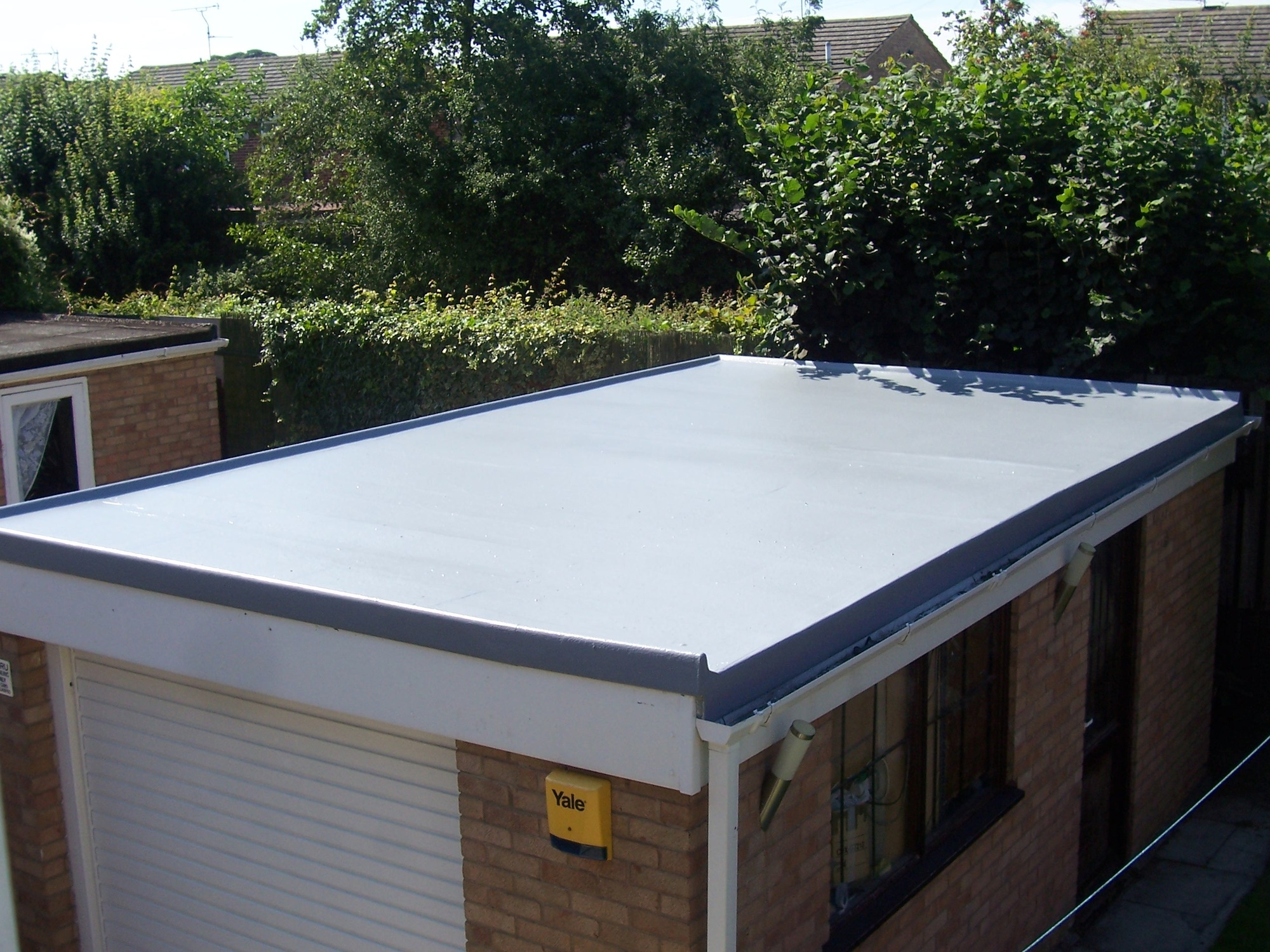 Pggrp fibreglass flat roofing specialists we specialise for Flat roof garage with deck plans