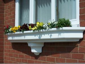 White fibreglass window planter on wall